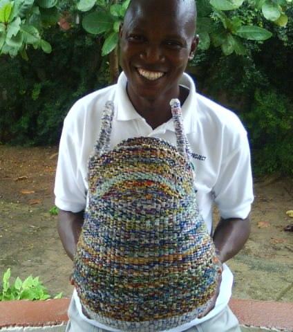 Godwin holding Bolga baskets