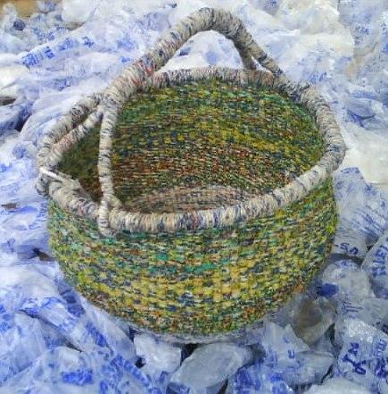 Traditional shaped Bolga basket on plastic waste