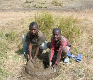 Village Children Help Out with Wall Building Ghana