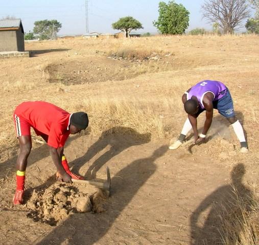 Footballers preparing mud Ghana