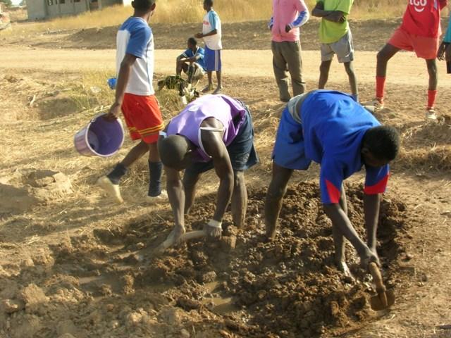 Football Team helping build walls Ghana